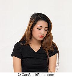 Asian woman in sad