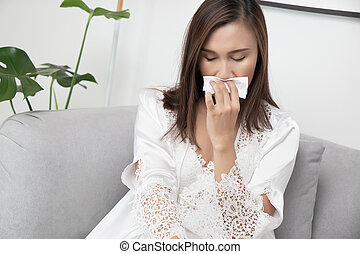 The girl in lace sleepwear has a snot at night