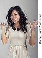 Asian woman in white dress