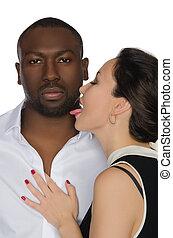Asian woman licks his cheek dark-skinned men isolated on white