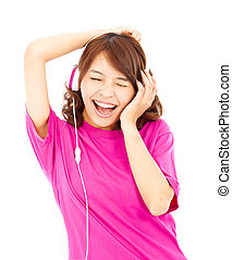 asian woman listening and enjoying music in headphones