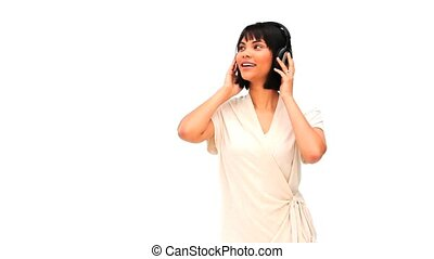 Asian woman listening to music with headphones
