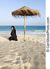 Asian woman on beach