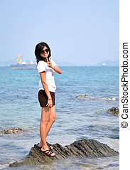 Asian woman on beach summer holiday