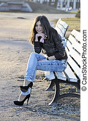 Asian woman on bench