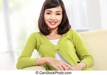 asian woman on the sofa