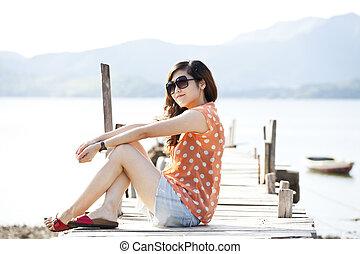 Asian woman on the wooden bridge