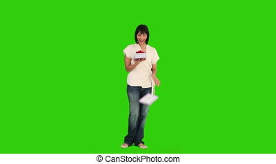 Asian woman opening her shopping bags - Chroma-key footage...