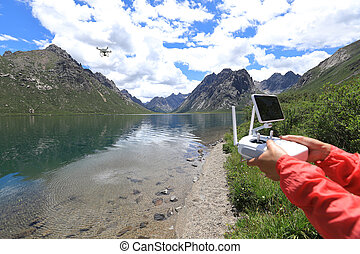 asian woman photographer flying drone outdoors