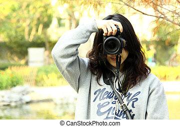 Asian woman photographer