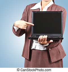 Asian woman pointing at her laptop.