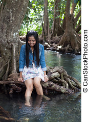 asian woman portrait in beautiful nature scene