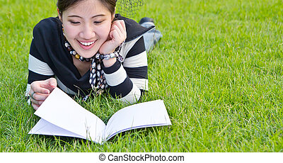 Asian woman reading notebook on the