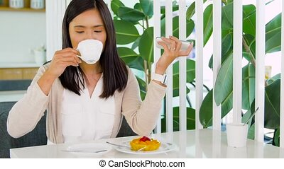 asian woman recording voice on smartphone at cafe -...