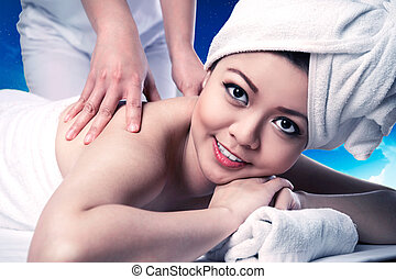 Asian woman relaxed on the spa