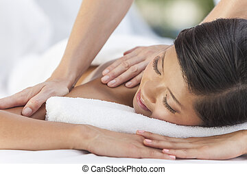 Asian Woman Relaxing At Health Spa Having Massage
