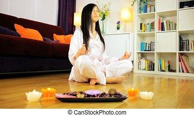 Asian woman relaxing doing yoga - Tracking shot of woman...