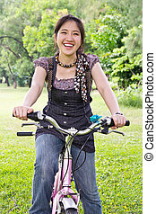 Asian woman riding bicycle