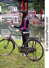 Asian woman riding bicycle with smile