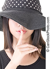 Asian woman saying hush be quiet - Close-up portrait of ...