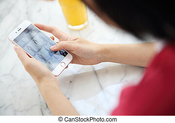 Asian woman shopping with smartphone