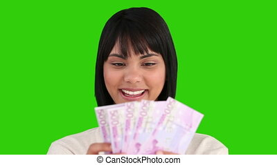 Asian woman showing us her cash