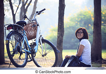 Asian woman sitting in the park wit