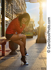 Asian woman sitting on bench