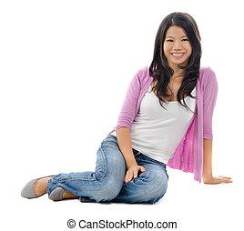 Asian woman sitting on floor