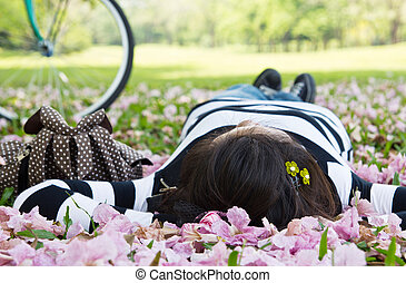 Asian woman sleeping on the grass