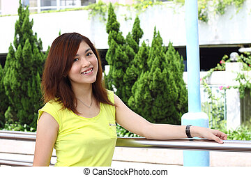 Asian woman smiling outdoor