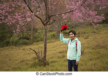 Asian woman stand among Pink flower King of tigers