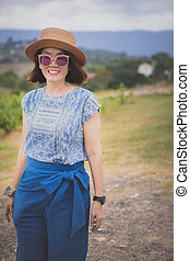 asian woman standing outdoor with toothy smiling