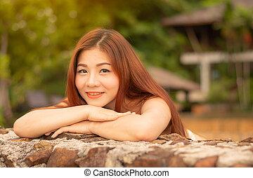 Asian woman standing