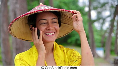 Asian woman talking on phone