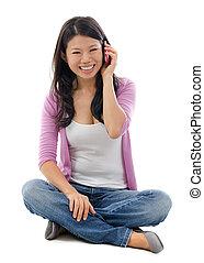 Asian woman talking on smart phone