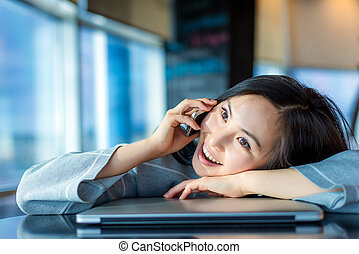 Asian woman, talking on the phone