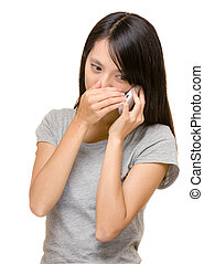 Asian woman talking phone secretly