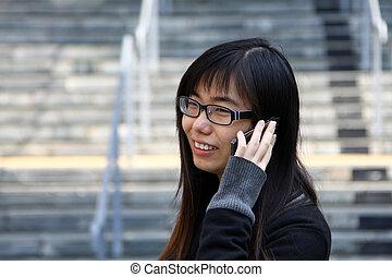 Asian woman talking phone