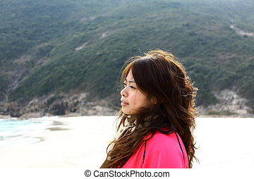 Asian woman thinking on the beach