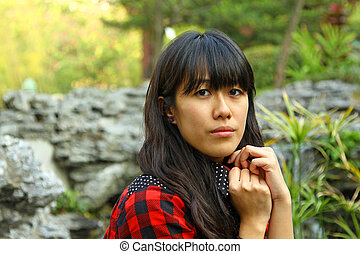Asian woman thinking