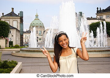 Asian woman tourist - Young woman doing peace sign while...