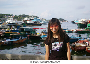 Asian woman travelling with smile