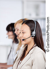 asian woman using headset in office