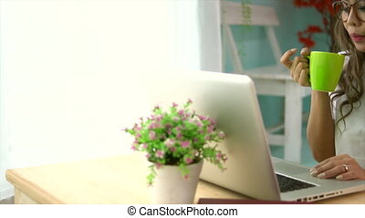 Asian Woman Using Her Laptop Having Coffee