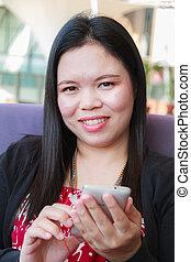 Asian woman using smartphone