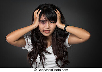 Asian woman victim of domestic abuse - A portrait of a asian...