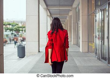 Asian woman walking outdoors