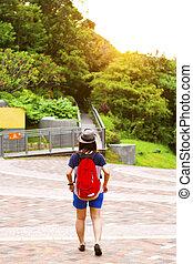 Asian woman walking