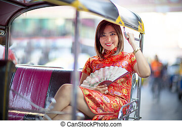 asian woman wearing chinese tradition clothes sitting in...